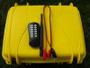 Included with the base model S32I firing system is an internal 12 volt SLA 2.3ah rechargeable battery, 90 degree antenna, external battery lead, two keys, and a the new black 200m handheld FSK transmitter. A yellow SE520 case is standard.