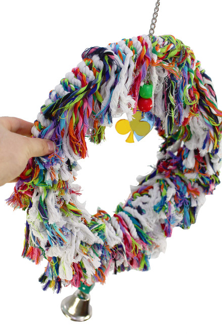 1017 Large fluffy ring swing is an explosion of soft-colored cotton rope with plastic beads, leather tied dice and a bell.