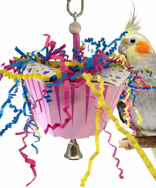 1058 Happy birthday is just a great way to celebrate with your small to medium-sized feathered friends. A colorful plastic cake cup is stuffed full with foraging, colored crinkly paper and adorned with colored plastic and foam pieces, it is finished out at the bottom with a small bell.