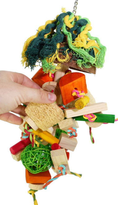 1913 Medium Buster is a busy toy for your medium-sized feathered friend, lots of colored and natural wood pieces, strung together with soft cotton rope, colored sisal, a woven basket, colored vine balls and a loofa.