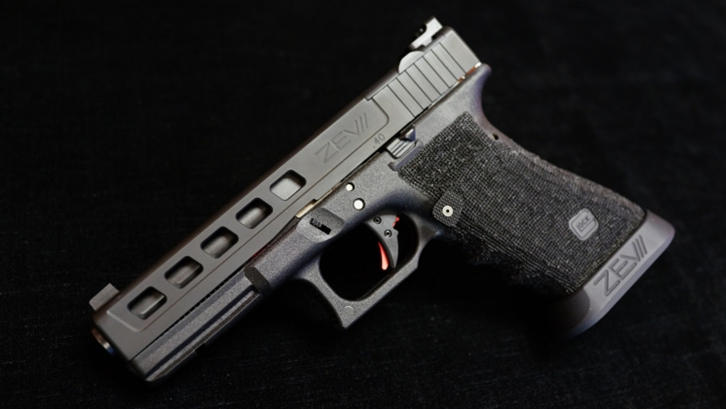 Glock 22 aftermarket modification by ZEV Customs - Signature Dragonfly Slide with RMR Cut