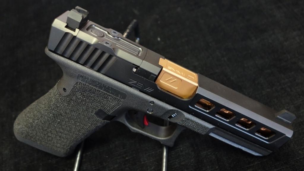 Glock 17 aftermarket modification by ZEV Customs - Dragonfly Black Slide RMR Cut