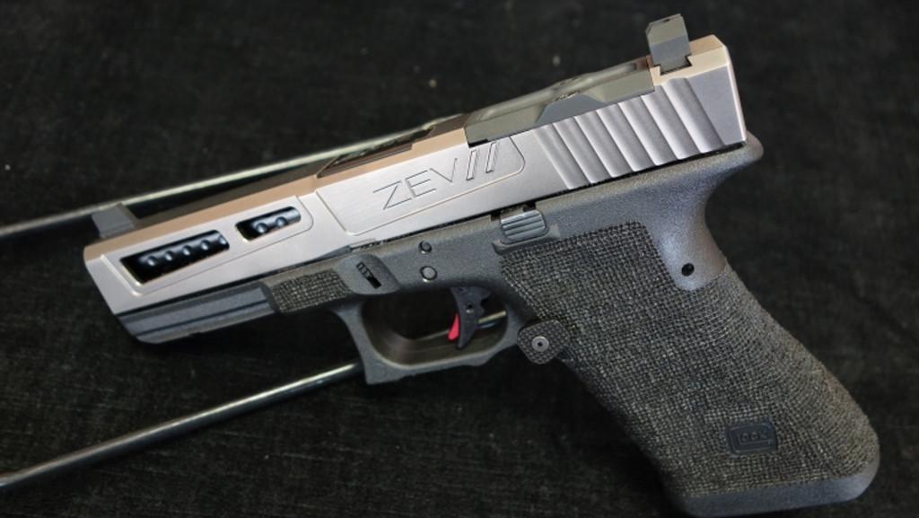 Glock 17 aftermarket modification by ZEV Customs - PrizeFighter DLC Grey Slide RMR Cut