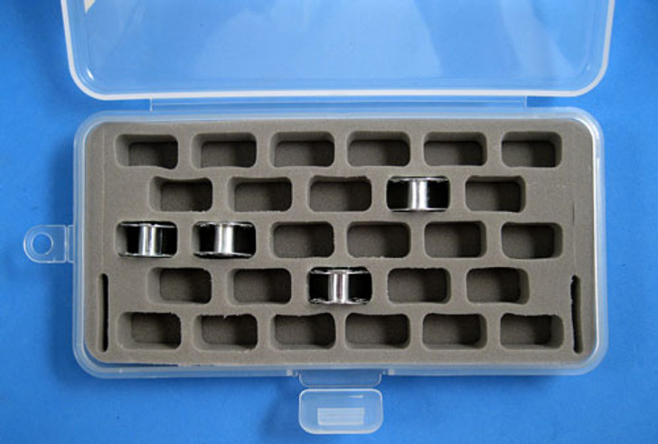 Holds 28 standard-size bobbins in a plastic case.