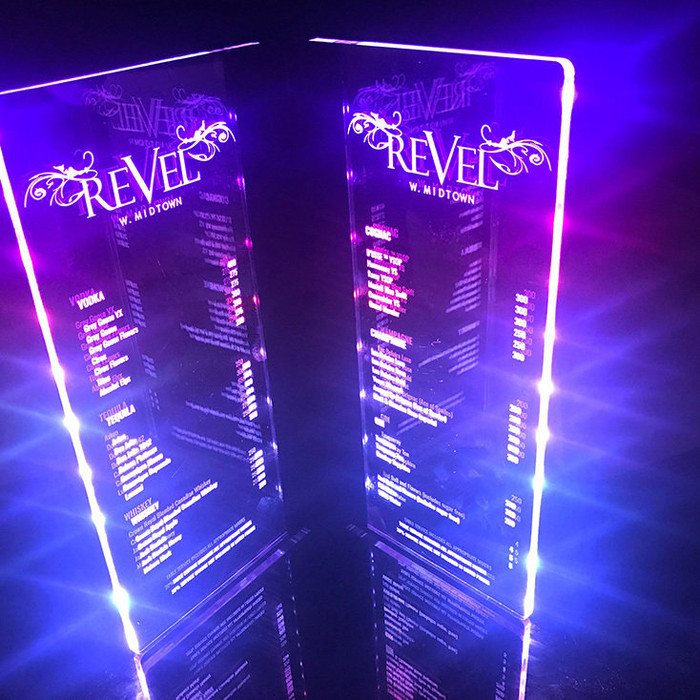 The Twilight LED Menu is constructed using high grade aluminum frames and two clear acrylic page panels. Illuminated by an array of 16 LED lights recessed at the edge of each acrylic panel to produce a bright rainbow effect which diffuses through your customized engraving and its outer edges.