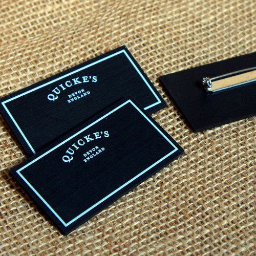 Printed blackboard badges - with room to write names below (with a chalkboard pen) under a preprinted logo.