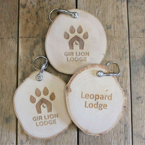 Wood Slice Keyfobs made from birch wood with optional shackle and split ring - all of your artwork is engraved into the wood