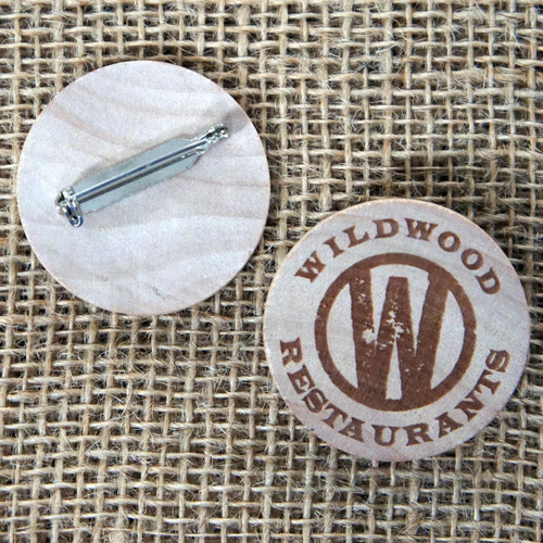 38mm round wooden badges. Engraved onto wooden tokens with pin fastener.
