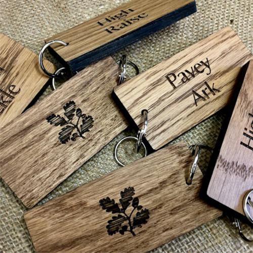 8mm thickness solid oak keyfobs / keyrings with custom engraving.