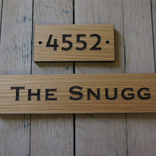 Engraved oak hotel door number and directional signs