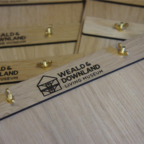 Wooden engraved A4 menu board with engraving on the rear and front top wooden clamp with wingnut fixing.