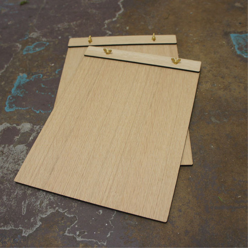 Wooden Wingnut Clipboards - unbranded in a light wood finish.  Available in three sizes, to suit either DL, A5 and A4 paper.  We can offer light or dark finish either with or without distressing on the wood.