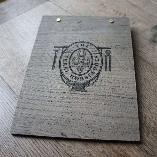 Rustic, distressed silver / grey wooden clipboard with wingnut clamp fixing.  With engraved graphic / logo to the rear.