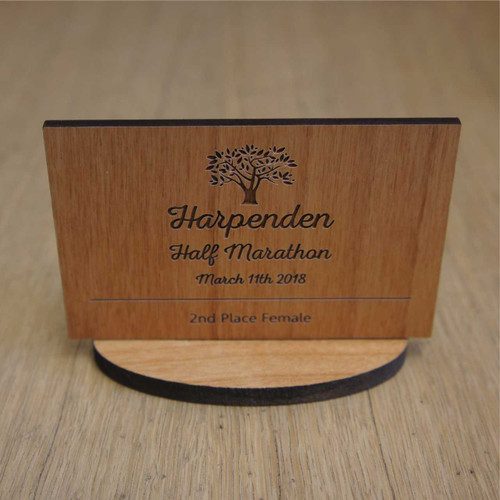 Small engraved wood award / trophy.  Each is produced from sustainable wood. Artwork is engraved into the wood top.