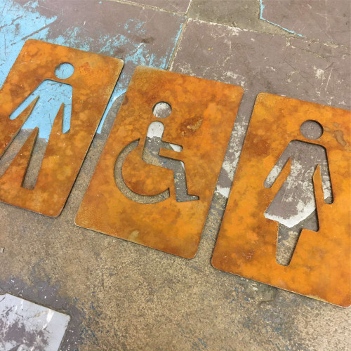Corten Steel Disabled Toilet Sign - shows the steel after the patina commenced! This listing is for one disabled toilet sign (not the 3 signs shown).