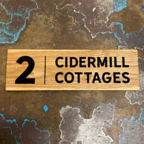 Engraved solid oak house signs.