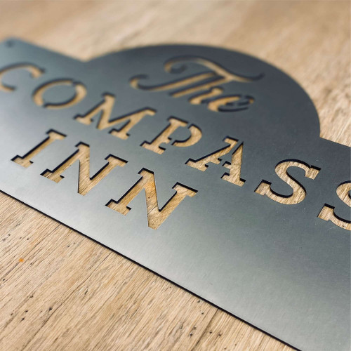 Stainless steel business signs. Laser cut for fine detail.