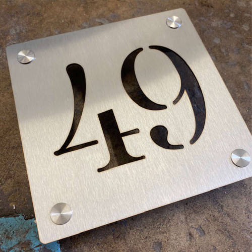 Stainless steel house number signs with optional stand off fixings.