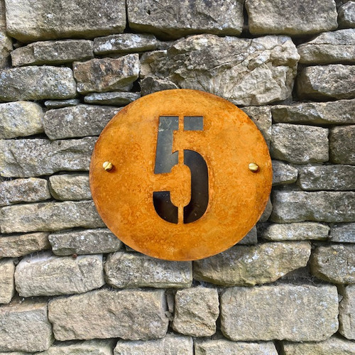 Round rusty steel house names and numbers. Rusty steel signs. Weathered steel signs. Corten steel signs. Corten steel round house number plaques.