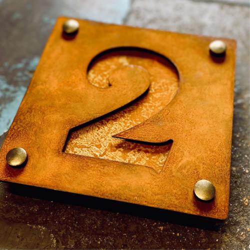 Corten steel house number plaque with corten steel backing plate. Rusty steel house number sign.