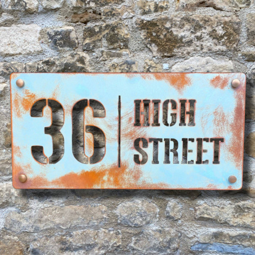 Distressed and painted rusty Corten steel house signs and house numbers.