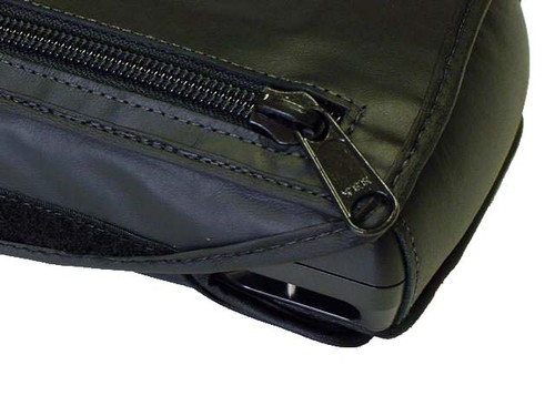 corner view    The BX 400/OMNI form fit custom leather case is designed to enable the Pac Mate user to easily utilize the note taker while the case is on the unit and allow the unit to be carried on a comfortable strap. The face of the unit is covered with a zipper pocket cover secured with heavy Velcro. The zipper pocket cover may be flipped on to the rear and secured under the unit if the user needed to utilize the note taker while walking. The zipper pocket includes inlayed credit card/ ID holders and two flash card holders which provide privacy and security for important information and data storage.  The BX 400/OMNI case is manufactured with high quality materials such as leather to provide durable outer protection, foam inlay, to provide cushion for the note taker and brush tricot with fabric interior to protect the keys and note taker cover. The case is equipped with a large heavy duty black metal zipper and black plastic hooks to provide security, durability and safety. In addition, the case is equipped with a On/Off switch cover plate which provides the user peace of mind the unit will not accidentally turn on when not in use. Finally, the case utilizes a one and a half inch adjustable heavy strap with a large comfortable shoulder strap. The strap includes an attachment to secure a GPS receiver.