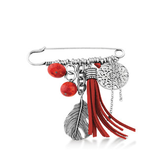 Magical array of semi-precious coral, burnished silver and suede elements combined on a designer pin