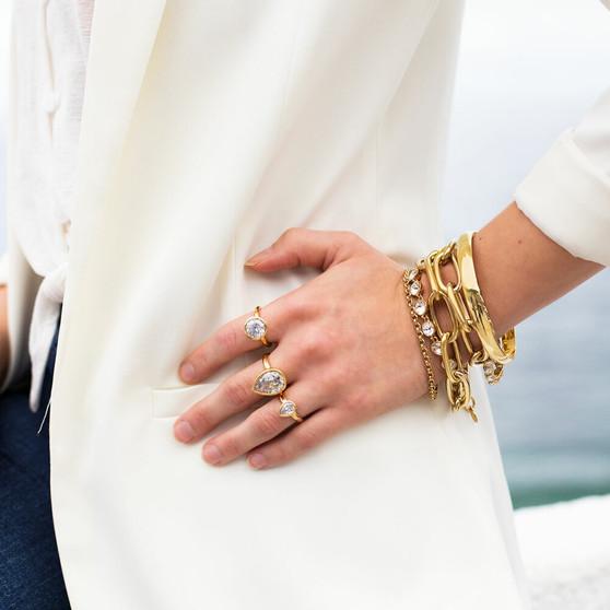 18ct Gold Vermeil Bold Cubic Zirconia Ring - RR380 - £95 18ct Gold Vermeil Bold Teardrop Sentiments Ring - RR385 - £105 Petite Teardrop Gold Vermeil Sentiments Ring - RR452 - £70 Hello Sunshine Tennis Bracelet - B1609 19cm - £130 Gold A-List Bracelet - B1616 19cm - £95 18ct Gold-Plated Bracelet - B1599 - £115 Sea Goddess Link Bracelet - B1618 20cm - £150