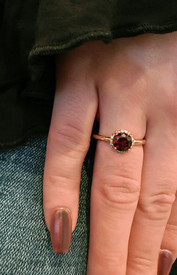 A delicate garnet ring.