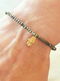 Hamsa in 18k gold with diamonds