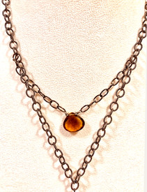 It's all one layered necklace