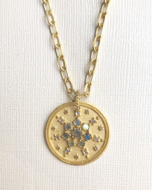 large disc pendant with diamonds