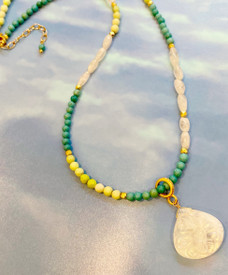Turquoise and carved Mother of Pearl Necklace