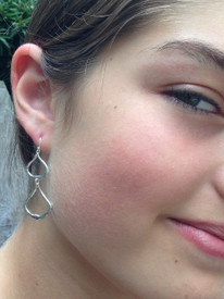 The silver seems be flowing in our handcrafted silver pagoda earring.