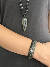 Oxidized silver and diamond pendant