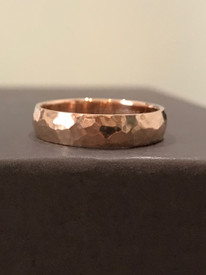 This is a 5mm width band men's wedding band, made in 14k rose gold