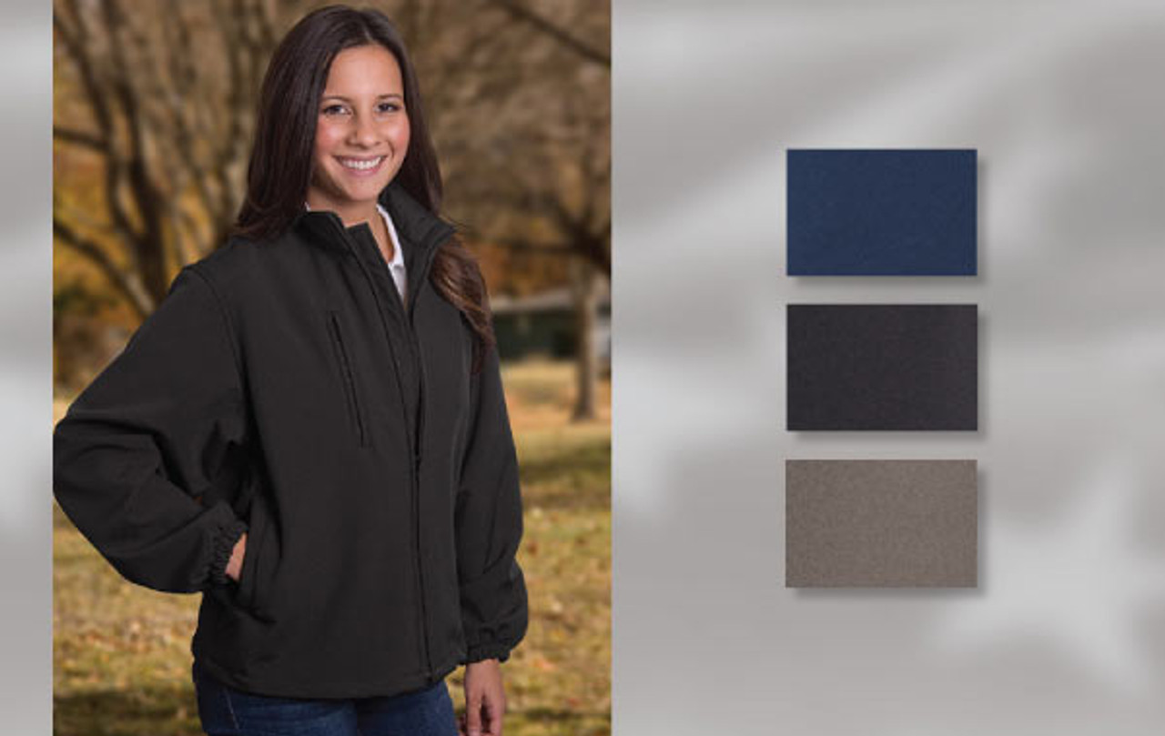 SOFT SHELL LADIES JACKET 94% polyester/6% spandex bonded fleece full zip jacket with zip through collar and additional right chest fashion zipper. Self-elastic cuff, welt pockets, inside storm flap and hemmed open-bottom. Union Made in USA.