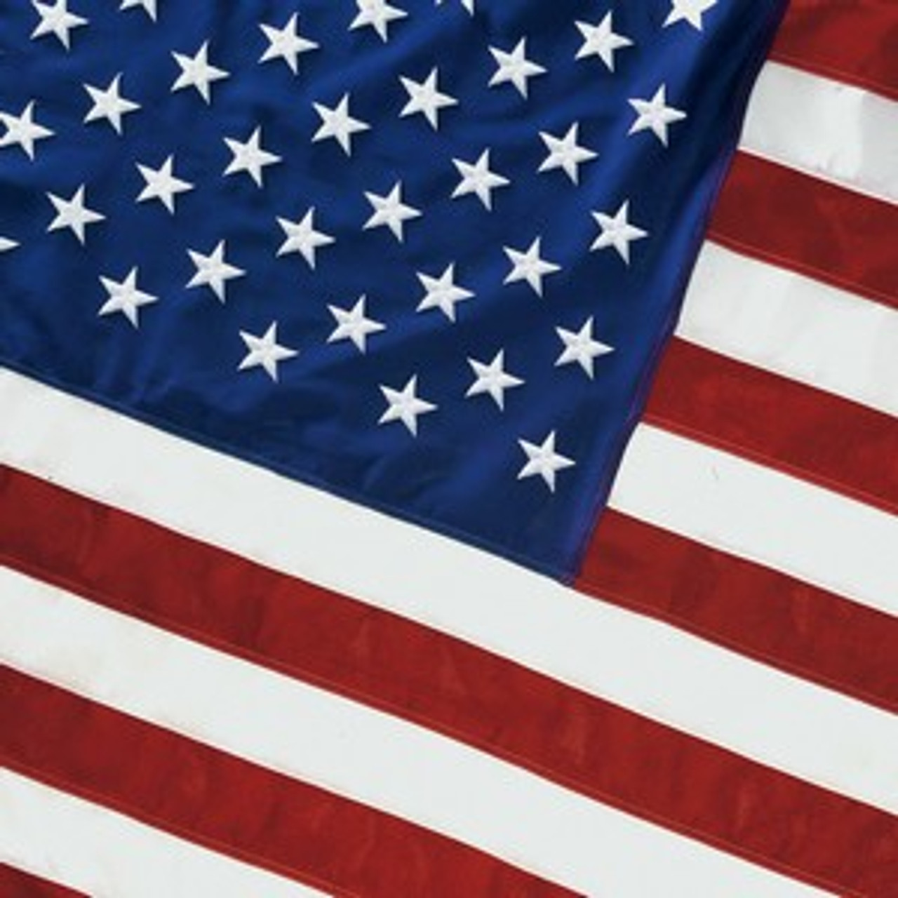 his 10'x15' 2-ply spun polyester U.S. flag comes with extra heavy, white polyester canvas heading with nylon rope and galvanized thimbles for added strength. To ensure stability and durability, a brass grommet is used in addition to the rope on the heading. This flag has sewn stripes and embroidered stars. Moderate to Difficult Weather Environment. Flag is 100% made in the U.S.A.