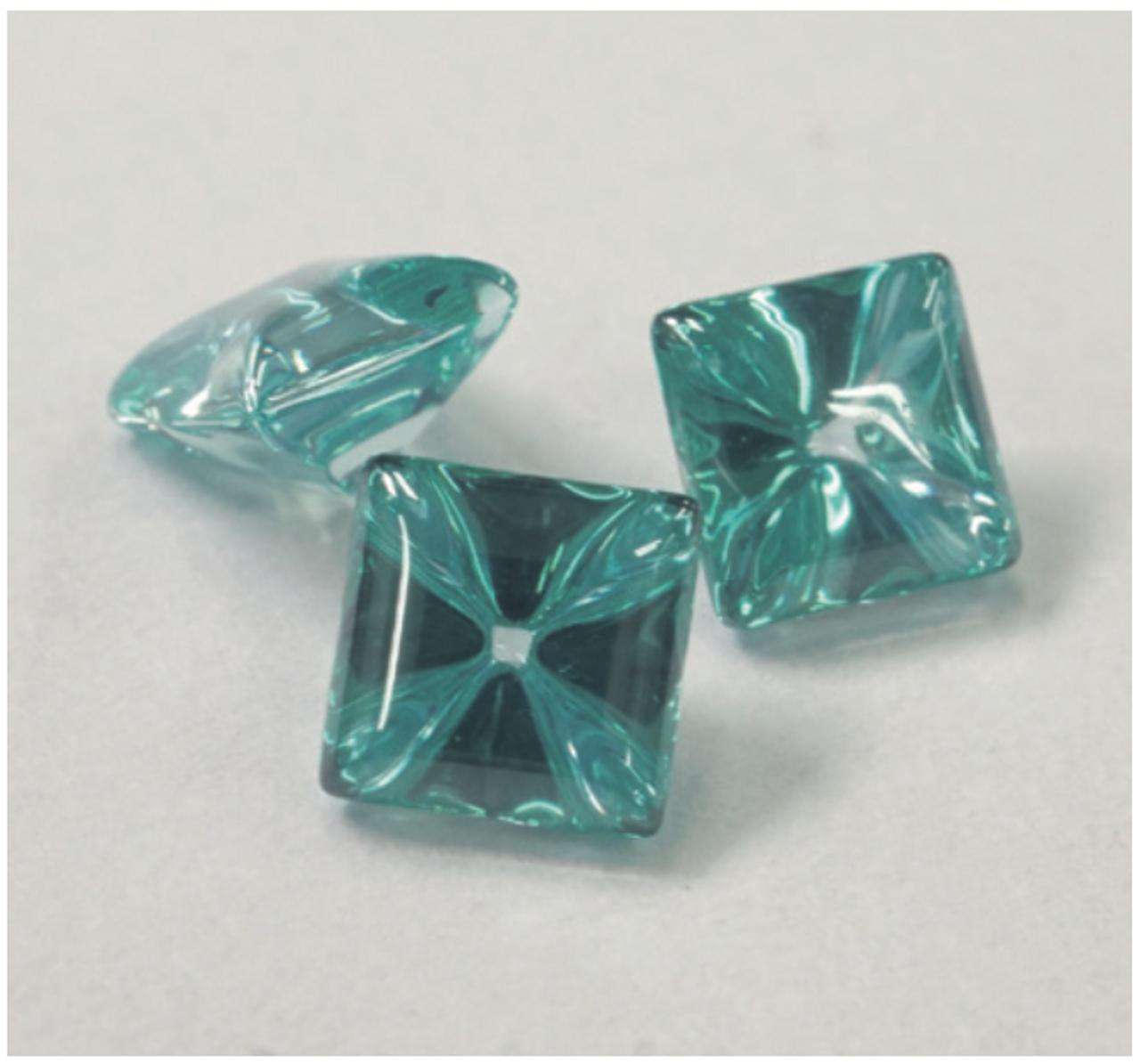 Liquid cut turquoise square stones.