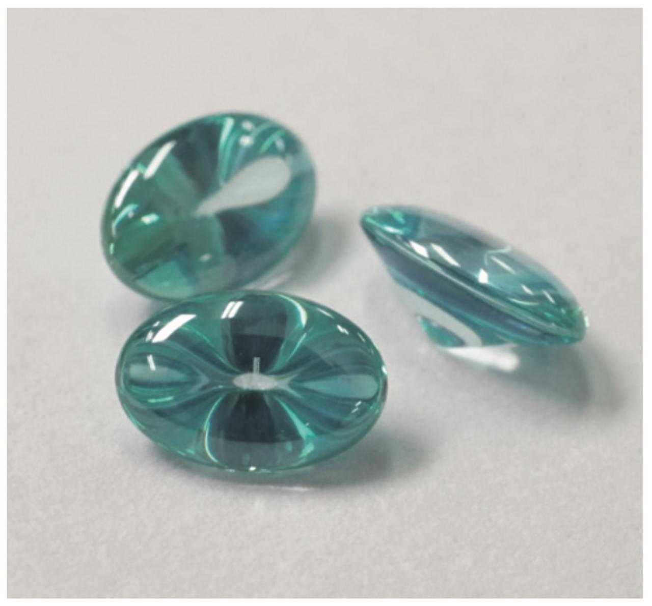 Liquid cut turquoise oval stones.