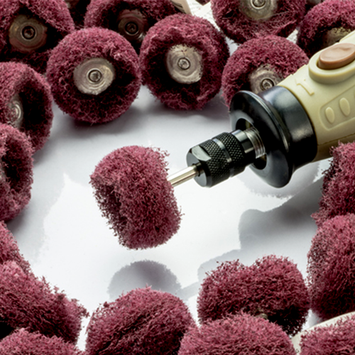 Abrasive wheel buff attached to a rotary tool (rotary tool sold separately).