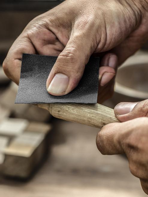 Silicon Carbide sanding paper.