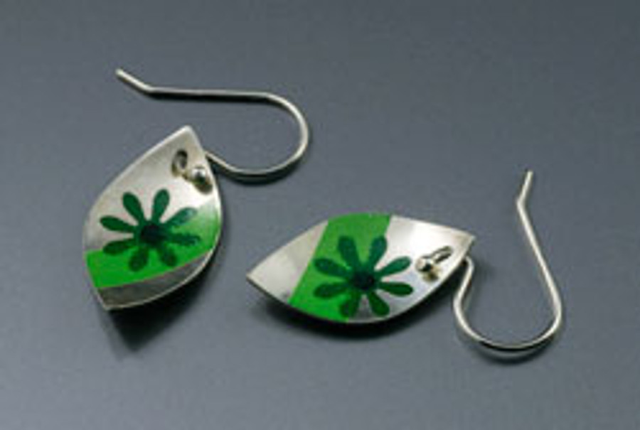 Earrings made by Helga van Leipsig, using the ceramic decals technique.