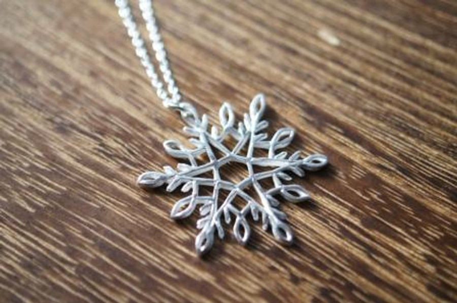Snowflake pendant made with a syringe