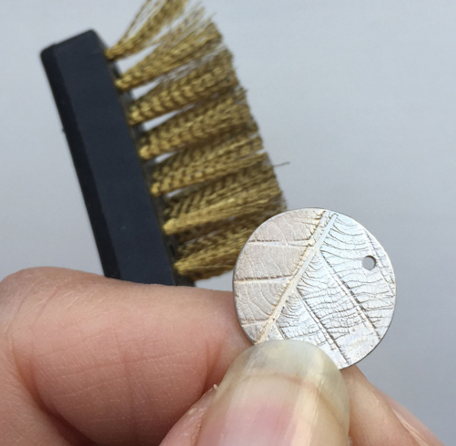 The brass brush in action.