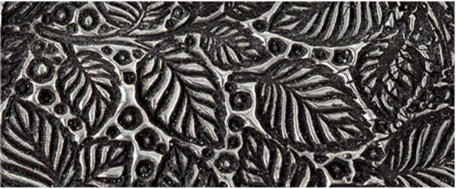 Texture in fired silver clay.