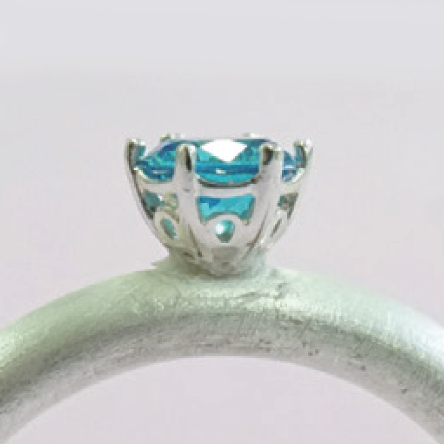 Crown embeddable prong bezel ring example.
