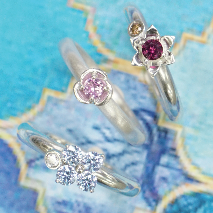Viola flower prong ring examples.