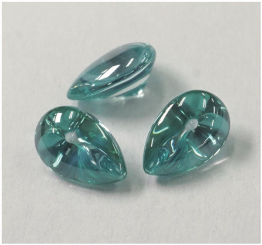 Liquid cut turquoise pear stones.