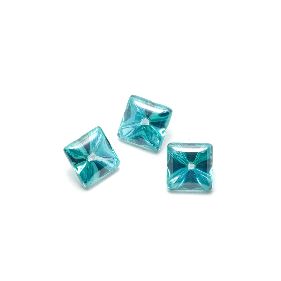 Liquid cut minty teal square stones.